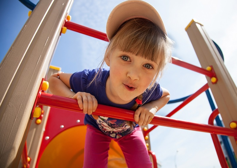 Girl on jungle gym shutterstock 205039507